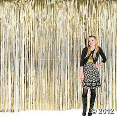 Gold tinsel backdrop, $16.95, www.orientaltrading.com