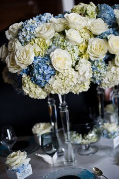 Mix of hydrangea and roses in blue. This is nice but need a smaller version for our farm to table style.