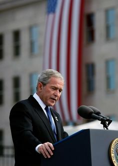 "U.S. President George W. Bush speaks during the Pentagon Memorial dedication ceremony on the seventh anniversary of the 9-11 terrorist attacks September 11, 2008 in Arlington, Virginia. U.S. President George W. Bush will dedicate the memorial, made up of 184 ""memorial units"" each dedicated to an individual victim killed at the Pentagon when American Airlines Flight 77 slammed into the Department of Defense's headquarters on September 11, 2001."