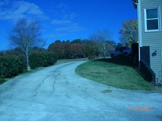 View from lower driveway towards street. This concrete area has parking for 5 cars for the basement apartment.