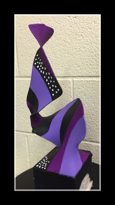Pantyhose, wooden block, clothes hanger, acrylic paint sculpture. My first attempt at this project with my students this past year. -C. Herrera