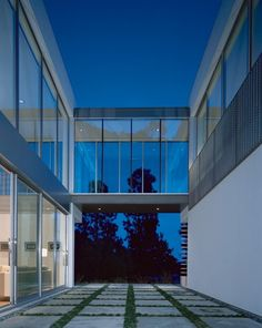 """TALKING POINT: Particularly dramatic is the glass-enclosed bridge connecting the two volumes. In Pali's own words, """"It's more than a hallway. It's a place where you can stop and think for a moment and look out—a place for contemplation.""""CONTACT: Sotheby's International Realty, 310-860-4510"""