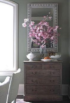 dresser, mirror, flowers