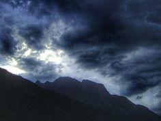 mountain, sky, tranquil scene, scenics, tranquility, beauty in nature, cloud - sky, mountain range, cloudy, nature, silhouette, cloud, weather, landscape, idyllic, overcast, majestic, dusk, cloudscape, non-urban scene