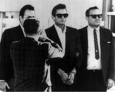 Johnny Cash being transfered from El Paso county jail to a federal courthouse after his drug arrest in 1965
