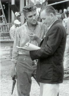 Great ElvisHistory Love Me Tender On The Set ,Elvis receiving instructions from Robert Buckner (screenplay) between takes. September 1956