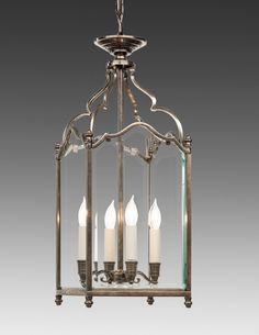 Style#LL-63-Cast brass and beveled glass English style four light lantern. Shown in custom antiqued nickel finish.