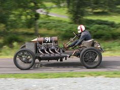 Naked PUNK-FUEL stripped down 1905 Darracq 200HP racer, get this 200hp in 1905 on a light chassis, no seat belt, why bother with the helmet? Built in the days of mad mad mad punks that found speed & gasoline intoxicating.