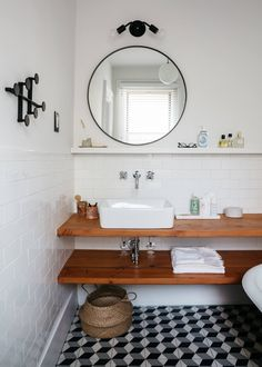 The bathroom has a Kraus Ceramic Sink, a California Faucets chrome Tiburon Lavatory Faucet, a Rejuvenation oil-rubbed bronze Round Mirror, and a Onefortythree Double Sconce. Source by remodelista Cabin Bathrooms, Attic Bathroom, Bathroom Layout, Small Bathroom, Bathroom Designs, Round Bathroom Mirror, Bathroom Canvas, Lavatory Faucet, Bathroom Faucets