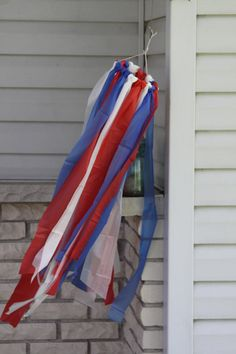plastic table cloths turned patriotic windsock ($3 makes 3 to 4 of these!)