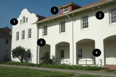 The Mission Revival elements of Fort Winfield Scott (Presidio) Building 1208:    1. Mission-shaped roof parapet  2. Wide, overhanging eaves with decorative brackets  3. Red clay roof tiles  4. Arched doorways  5. Deep window openings without any framing, except the sill