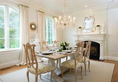 Lots of white, a little beige, lots of sushhine.  (Paint the little Queen Anne table and/or chairs like this or replace?) Add green and perk up with points of other sparkling colors in small amounts without pulling attention from the view.