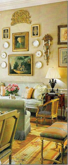 (BrandonRugs.com) All that glitters is not gold...but the handwoven Aubusson rug (that establishes and harmonizes the gilded theme seen in this living room) has a value possibly worth its weight in gold for the integrity it brings to the room.