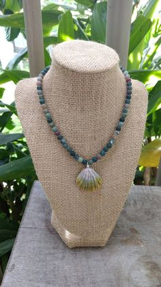 Check out this item in my Etsy shop https://www.etsy.com/listing/493533712/hawaiian-sunrise-shell-beaded-choker