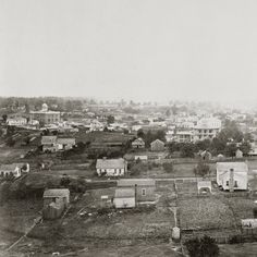 In 1864, George N. Barnard climbed into the cupola of the Atlanta Female Institute for this view of Atlanta looking southwest toward the center of the city. At the far left is the domed Atlanta Medical College with the Atlanta Machine Works visible above and to the right. Today, the Sheraton Atlanta Hotel near the corner of Ellis and Courtland Streets occupies the site of the Atlanta Female Institute. #atlanta #civilwar