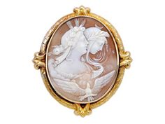 Antique Cameo and 18K Gold Brooch, circa 1870 Centering an oval shell cameo depicting the allegory of day and night.