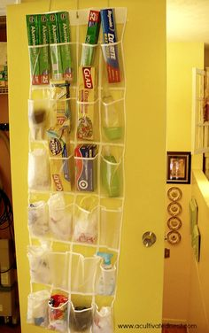 Use a over the door shoe hanger to organize foil, plastic wrap, cleaning products, sponges, whatever will fit in the pockets.