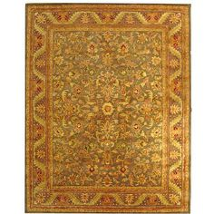 <li>Add interest to your home decor with a hand-tufted rug</li><li>Rug features a traditional pattern with stunning accents of green, rose, gold and ivory on a charcoal background with a charcoal border</li><li>Area rug is crafted of 100-percent wool</li>