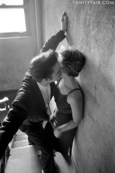"""On the threshold of becoming rock 'n' roll's King, Elvis Presley—at the ripe age of 21—was often in the company of mysterious women, but perhaps none so famously mysterious as the blonde in black in photographer Alfred Wertheimer's widely reproduced """"The Kiss"""" photograph, taken backstage before a concert in Richmond, Virginia, in the summer of 1956. Nearly 55 years after Elvis touched tongues with his date du jour, writer Alanna Nash last reveals the identity of the Mystery Woman, now 75"""
