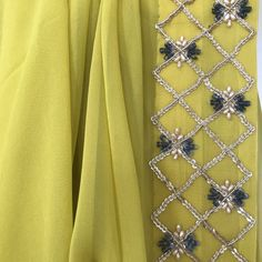 This lime green georgette sari is embellished with delicate hand embroidered border with pearls and Sequin along with plenty of vintage charm. Sari comes with a satin underskirt. Zardosi Embroidery, Pearl Embroidery, Border Embroidery Designs, Kurti Embroidery Design, Bead Embroidery Patterns, Hand Embroidery Flowers, Hand Work Embroidery, Couture Embroidery, Embroidery Fashion