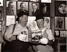 A candid shot of comic legends Stan Laurel and Oliver Hardy enjoying the latest issue of SPY SMASHER, circa 1940s!