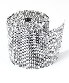 Ordered lots of rolls of this for the top of the centerpieces, around the bouquet and whatever else we can use it for.