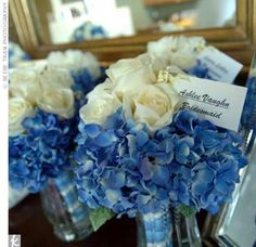 Amanda and her bridesmaids carried bouquets of cream roses with blue hydrangeas, and the men's boutonnieres were a single cream-colored rose with a sprig of blue hydrangea.