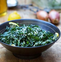 Healthy raw kale never tasted so good! Try this quick and amazingly delicious kale salad with lemon, honey shallots and parmesan, from Panning The Globe.