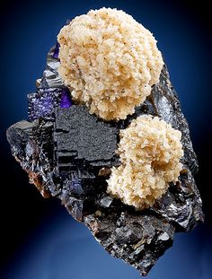 Fine combination of dark Purple Fluorite cubes on Sphalerite with Barite clusters