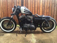 2012 Harley sportster 48 1200cc Raised tank Ignition and coil relocation Drag bars Smoked turning lenses Sik octane pipe Custom paint Shorty shocks Chopped and lowered rear fender Biltwell springer...