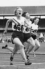 1956: Betty Cuthbert, eighteen, wins the gold medal in the 200 meters at the Melbourne Games. The Australian will win two more gold medals during the 1956 Olympics.
