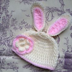 Crochet bunny hat.  There isnt much cuter than a baby bunny...or a baby in a bunny hat!  It features:  - bunny ears - flower - Choice of colour: White and pink/cream and pink/grey and pink. Please choose your colour in the variation dropdown box border/plait colour. Machine washable. 30 degrees.  Available in sizes up to toddler/preschooler.  This hat is made to order, please allow for 2-3 days before posting.  Made using a combination of patterns by repeatcrafterme.com an... Crochet Bunny, Crochet Hats, Bunny Hat, 30 Degrees, Plait, Baby Bunnies, Easter Gift, Baby Hats, Ears
