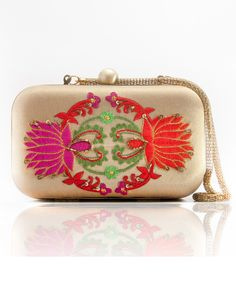 Designer gold clutch embroidered with pink and orange lotus motif   1. Gold hand clutch comes with embroidery of pink and orange lotus motifs2. The pearl button closure on the top with gold metal belt