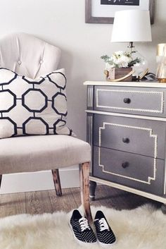 Style an empty corner with a pretty tufted chair, fluffy rug, and a simple chest of drawers.