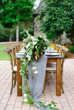 For an outdoor shower or wedding reception, keep the table setting simple and rustic with this gorgeous cascading floral runner. Fresh flowers are the perfect, elegant decor idea for an indoor or outdoor upscale event.