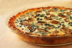 mushroom and fresh spinach quiche with shredded potato crust