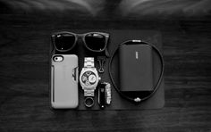 Ray-Ban••Folding Wayfarer + iPhone 5s w/Speck••Card Case + Fossil••ME1121 Machine Twist Analog Watch + Tungsten Carbide••Ring w/Carbon Fiber Inlay + Officemate••Micro Binder Clip + Swarovski••Nano Crown Necklace + Anker••12000 mAh Astro 34A Output External Battery + Victorinox••Signature Pocket Knife