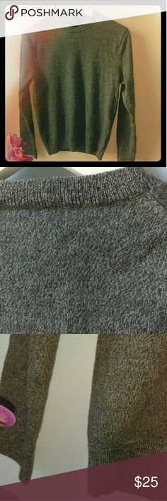 Banana Republic merino wool gray sweater Everything is perfect except 2 small holes on the left side under the arm. See picture 4.Very warm and lightweight! Measurements are laying flat: Chest/bust -17inches  Shoulder to bottom hem-22-23 inches Banana Republic Tops