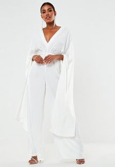 a plunge neck satin wedding jumpsuit featuring pleated bust and open back with long kimono style sleeves. regular fit wide leg with heels - sits just off the floor in heels polyester Noara wears a UK size 8 / EU size 36 / US size 4 and her height is Wedding Rompers, Wedding Jumpsuit, White Outfits For Women, All White Outfit, White Kimono, Satin Kimono, Long Kimono, Suit And Tie, White Satin