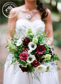 Anemone bouquet-white anemones, wine burgundy ranunculus, white veronica, bells of Ireland, maiden hair fern, asparagus fern, wine mini calla lilies, green hypericum berries, berzelia berries, and green kermit mums