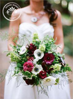 Anemone bouquet-white anemones, wine burgundy ranunculus, white veronica, bells of Ireland, maiden hair fern, asparagus fern, wine mini calla lilies, green hypericum berries, berzelia berries, and green kermit mums