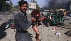 A Pakistani security officer carries an injured child from the site of bombing in Quetta, Pakistan, Wednesday, Sept. 7, 2011. A pair of suicide bombers attacked the house of a top military officer in the southwestern city of Quetta on Wednesday, killing his wife and 18 other people, at least eight of them soldiers, authorities said.