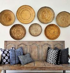 Woven baskets on the wall. love this re-purposed bench and pillows too!