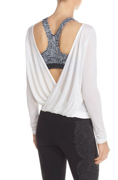 Love this ballet-inspired long-sleeve top with a reversible design that allows the V-neck to be draped in front or back to show off the sports bra or tank underneath.