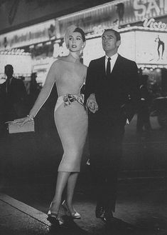 A fantastically chic night on the town, August 1957. #vintage #fashion #1950s