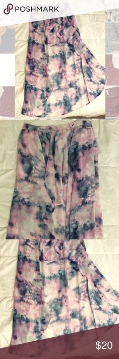 High-Low Tye Dye Skirt So cute and flowy when worn. Size large. Clean. Make a offer! Or bundle for more savings! Skirts