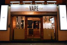 Vape Lab is the home of London's first e-cigarette coffee shop where multiple varieties and flavors of both the electronic cigarettes and java will be offered-- and now a cocktail bar. Oh gonna go here! Retail Display Cases, Window Display Retail, Store Displays, Retail Displays, Window Displays, Vape Store Design, Vape Design, Coffee Lab, Coffee Shop