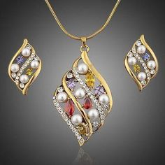 Gold Plated Multi Color Crystal Stud Earrings & Pendant Set  #rings #necklace #earrings #khaista #women #jewelry #womensfashion #fashion #dresses