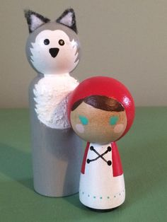Little Red Riding Hood and the Big Bad Wolf Peg Dolls. Story dolls. retelling the story , imaginative play , peg dolls , wood, cake toppers by BambiniToys on Etsy https://www.etsy.com/listing/218509400/little-red-riding-hood-and-the-big-bad