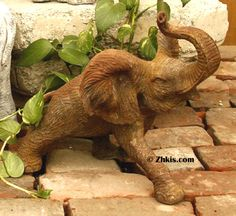 .Running outdoor elephant statue made from durable fiberglass and fiber stone both excellent piece for a deck or patio will take the outdoor weather year round